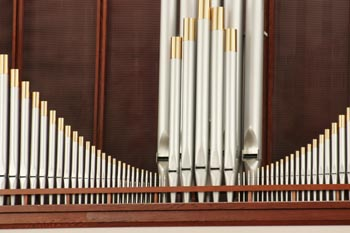 Organ pipes with woodwork on the bottom
